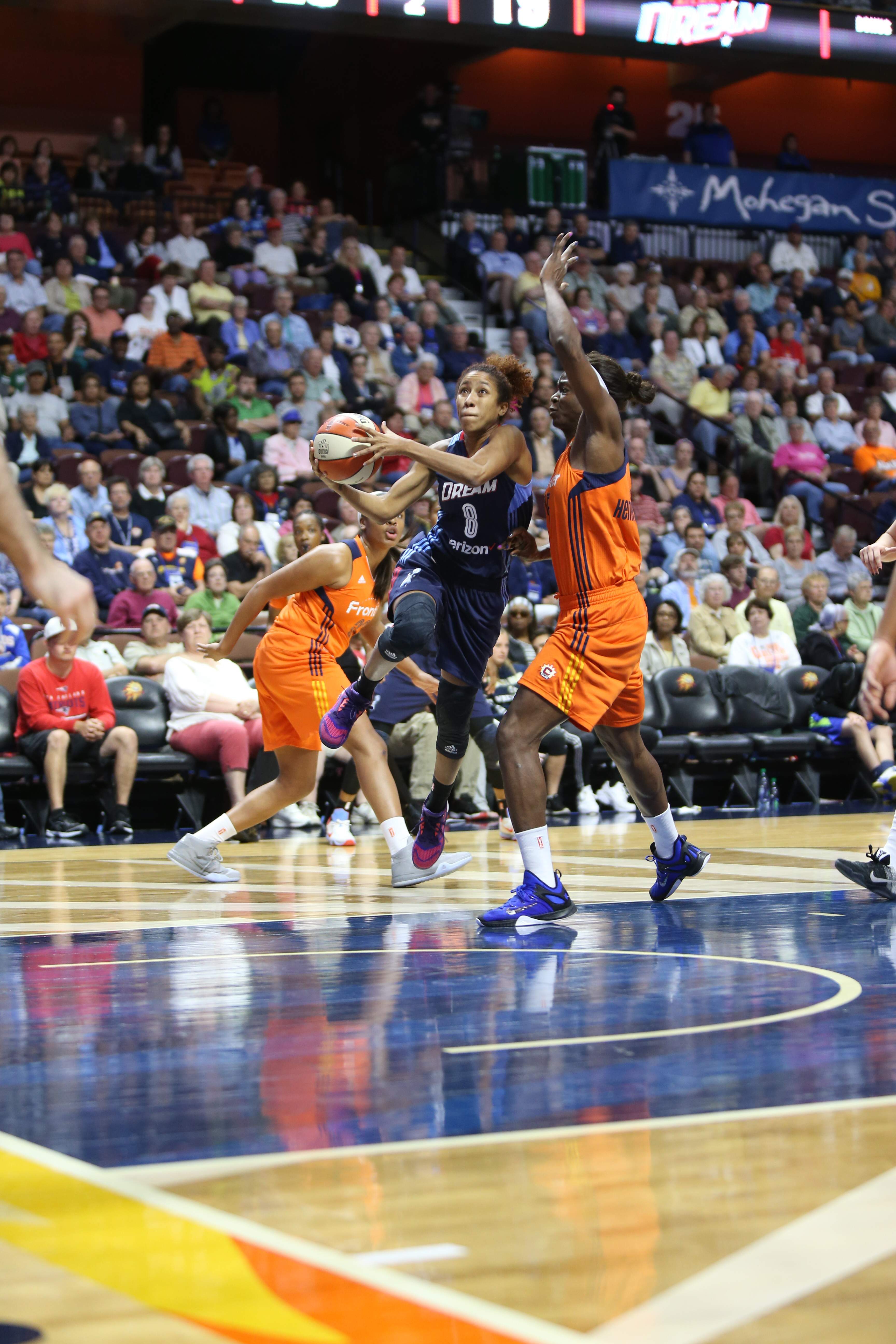 UNCASVILLE, CT - JUNE 3: Carla Cortijo #8 of the Atlanta Dream handles the ball against the Connecticut Sun on June 3, 2016 at Mohegan Sun Arena in Uncasville, CT. NOTE TO USER: User expressly acknowledges and agrees that, by downloading and or using this Photograph, user is consenting to the terms and conditions of the Getty Images License Agreement. Mandatory Copyright Notice: Copyright 2016 NBAE (Photo by Chris Marion/NBAE via Getty Images)