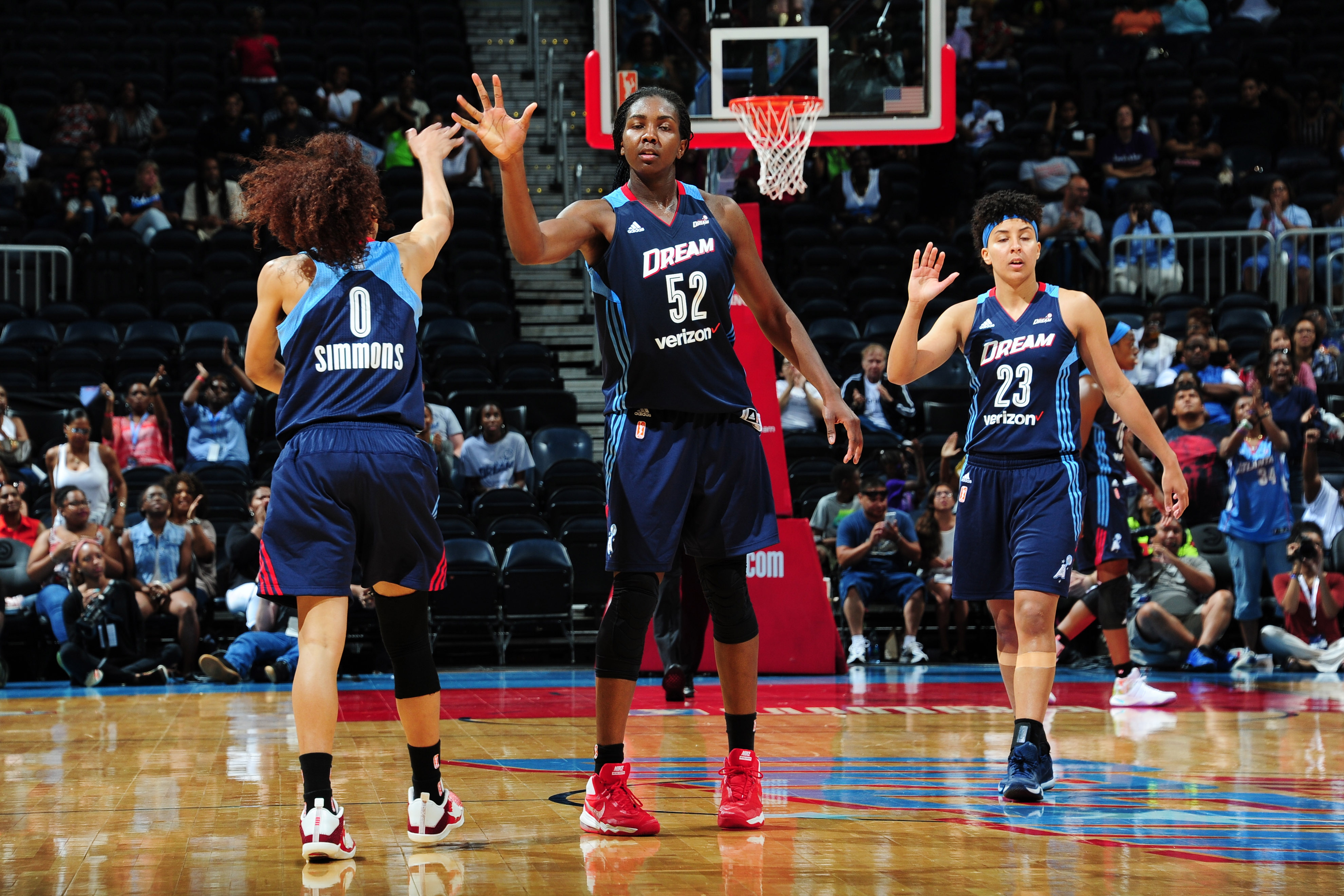 ATLANTA, GA - JUNE 12: Meighan Simmons #0 high fives teammate Elizabeth Williams #52 of the Atlanta Dream after a play against the Connecticut Sun during the game on June 12, 2016 at Philips Arena in Atlanta, Georgia. NOTE TO USER: User expressly acknowledges and agrees that, by downloading and or using this Photograph, user is consenting to the terms and conditions of the Getty Images License Agreement. Mandatory Copyright Notice: Copyright 2016 NBAE (Photo by Scott Cunningham/NBAE via Getty Images)