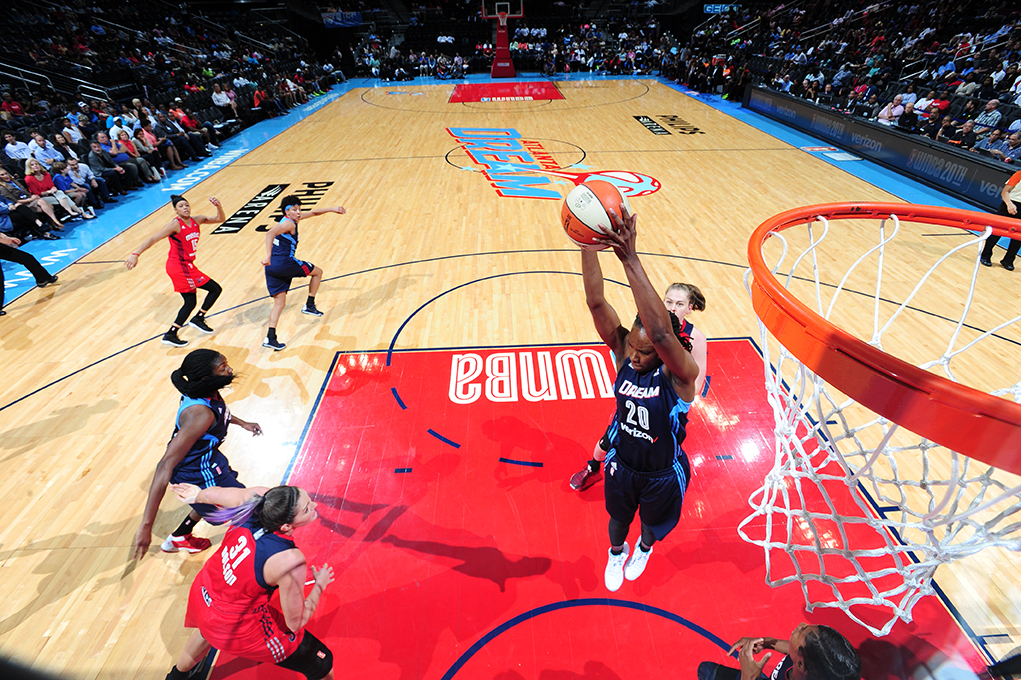 ATLANTA, GA - JUNE 5: Sancho Lyttle #20 of the Atlanta Dream grabs the rebound against the Washington Mystics on June 5, 2016 at Philips Arena in Atlanta, Georgia.  NOTE TO USER: User expressly acknowledges and agrees that, by downloading and/or using this Photograph, user is consenting to the terms and conditions of the Getty Images License Agreement. Mandatory Copyright Notice: Copyright 2016 NBAE (Photo by Scott Cunningham/NBAE via Getty Images)