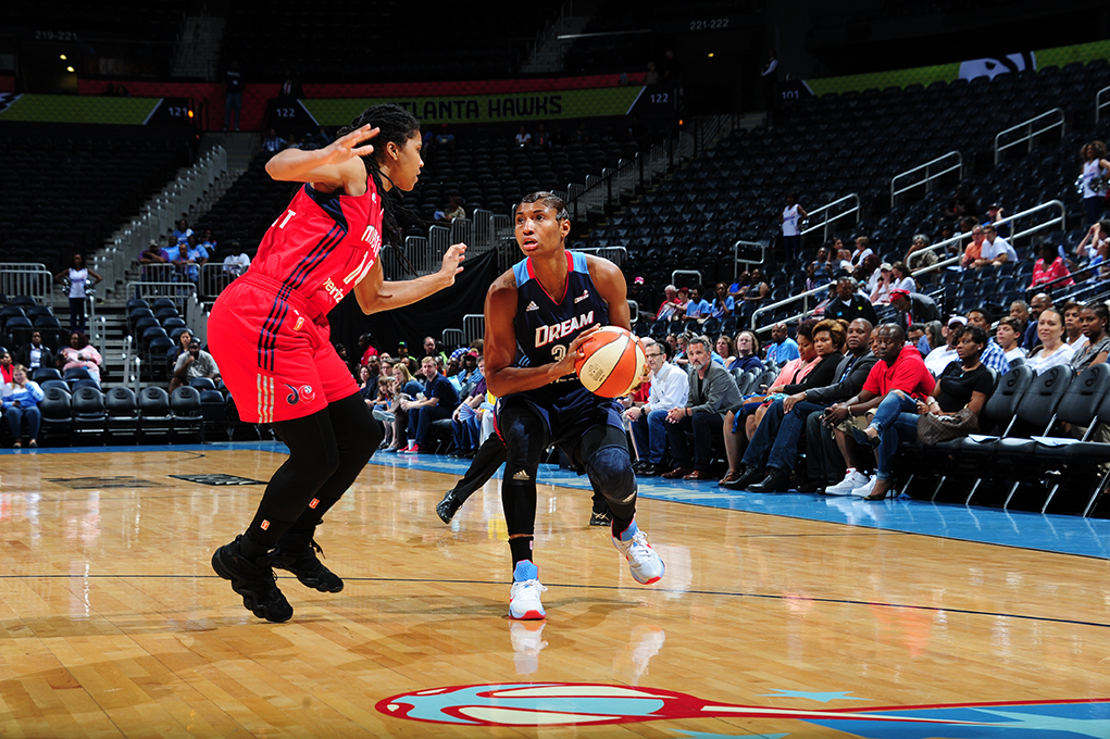 ATLANTA, GA - JUNE 5: Angel McCoughtry #35 of the Atlanta Dream handles the ball against the Washington Mystics on June 5, 2016 at Philips Arena in Atlanta, Georgia.  NOTE TO USER: User expressly acknowledges and agrees that, by downloading and/or using this Photograph, user is consenting to the terms and conditions of the Getty Images License Agreement. Mandatory Copyright Notice: Copyright 2016 NBAE (Photo by Scott Cunningham/NBAE via Getty Images)