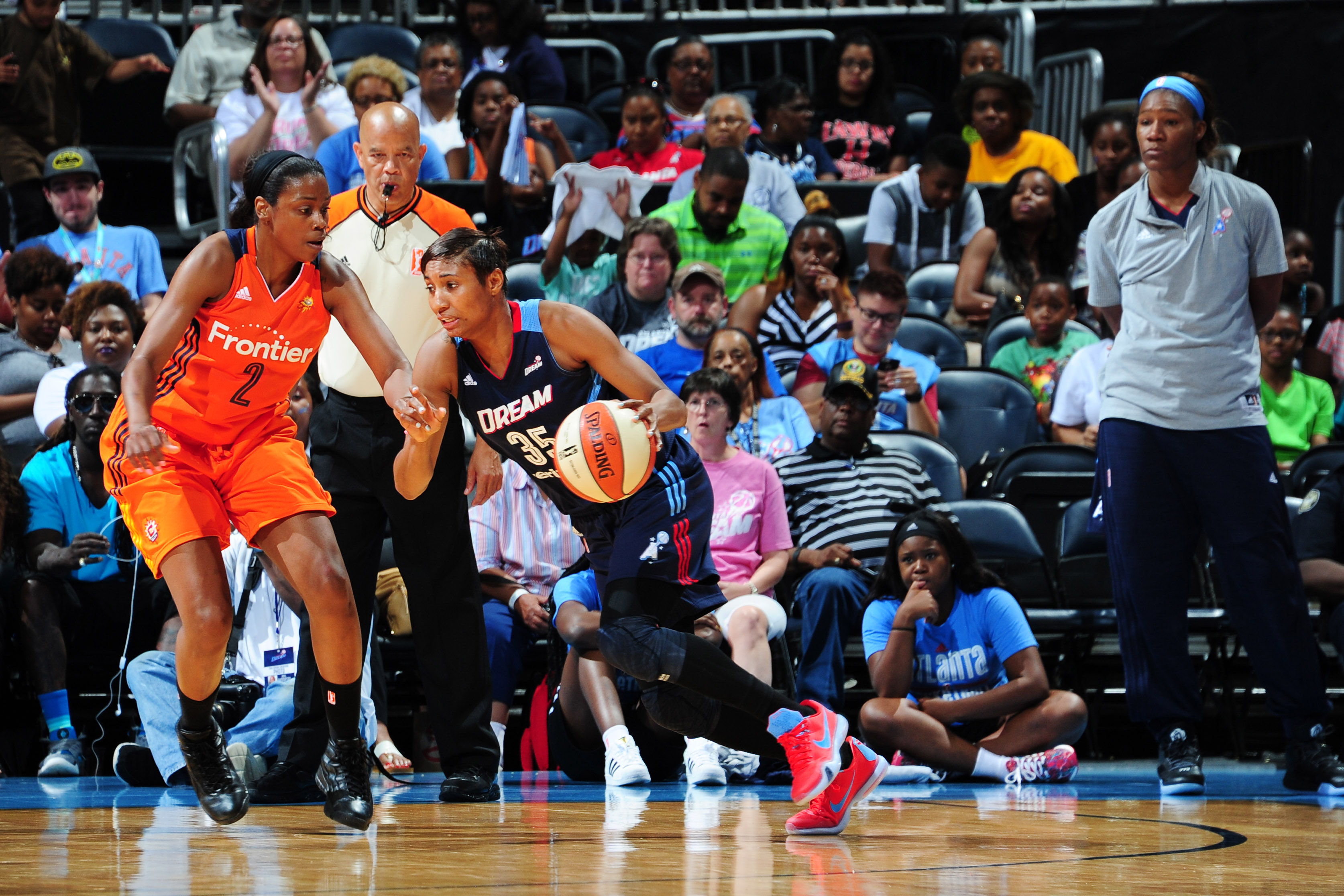 ATLANTA, GA - JUNE 12: Angel McCoughtry #35 of the Atlanta Dream drives to the basket against Camille Little #2 of the Connecticut Sun during the game on June 12, 2016 at Philips Arena in Atlanta, Georgia. NOTE TO USER: User expressly acknowledges and agrees that, by downloading and or using this Photograph, user is consenting to the terms and conditions of the Getty Images License Agreement. Mandatory Copyright Notice: Copyright 2016 NBAE (Photo by Scott Cunningham/NBAE via Getty Images)