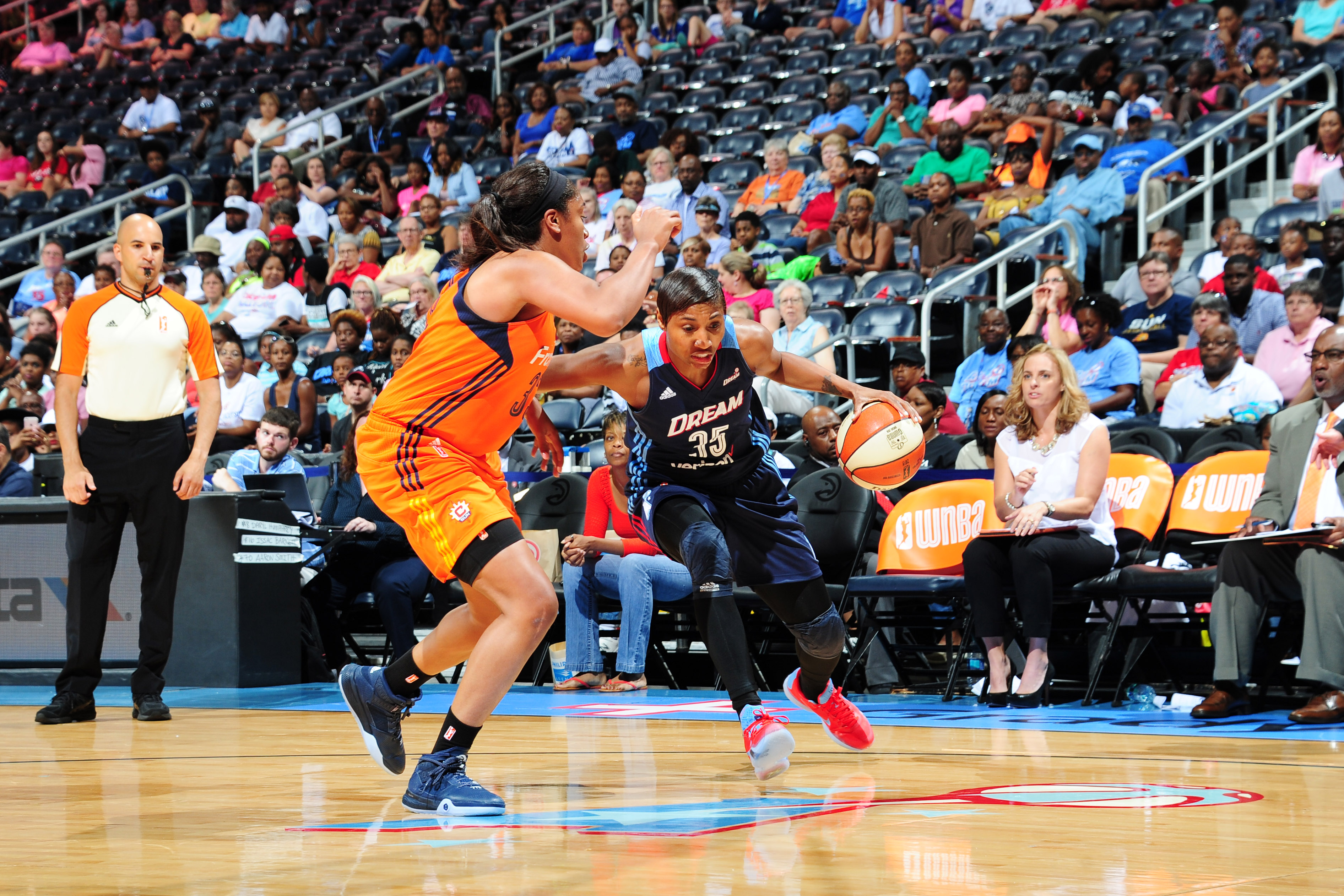 ATLANTA, GA - JUNE 12: Angel McCoughtry #35 of the Atlanta Dream moves the ball against the Connecticut Sun during the game on June 12, 2016 at Philips Arena in Atlanta, Georgia. NOTE TO USER: User expressly acknowledges and agrees that, by downloading and or using this Photograph, user is consenting to the terms and conditions of the Getty Images License Agreement. Mandatory Copyright Notice: Copyright 2016 NBAE (Photo by Scott Cunningham/NBAE via Getty Images)