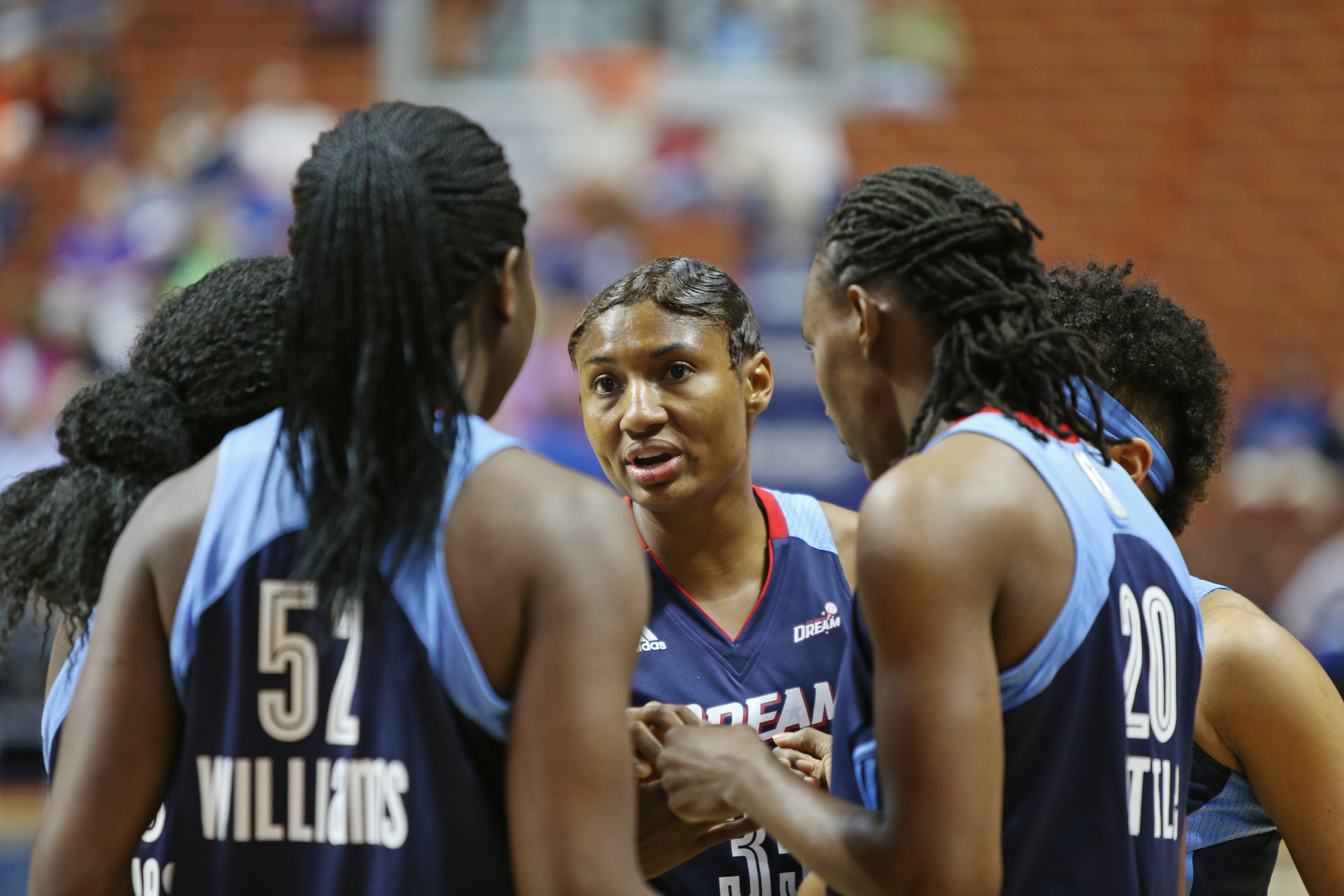 UNCASVILLE, CT - JUNE 3: Angel McCoughtry #35 of the Atlanta Dream and her teammates huddle during the game against the Connecticut Sun on June 3, 2016 at Mohegan Sun Arena in Uncasville, CT. NOTE TO USER: User expressly acknowledges and agrees that, by downloading and or using this Photograph, user is consenting to the terms and conditions of the Getty Images License Agreement. Mandatory Copyright Notice: Copyright 2016 NBAE (Photo by Chris Marion/NBAE via Getty Images)