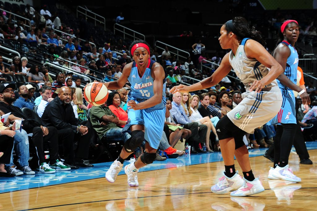 ATLANTA, GA - JUNE 10: Tiffany Hayes #15 of the Atlanta Dream drives to the basket against Jia Perkins #7 of the Minnesota Lynx on June 10, 2016 at Philips Arena in Atlanta, Georgia. NOTE TO USER: User expressly acknowledges and agrees that, by downloading and/or using this Photograph, user is consenting to the terms and conditions of the Getty Images License Agreement. Mandatory Copyright Notice: Copyright 2016 NBAE (Photo by Scott Cunningham/NBAE via Getty Images)