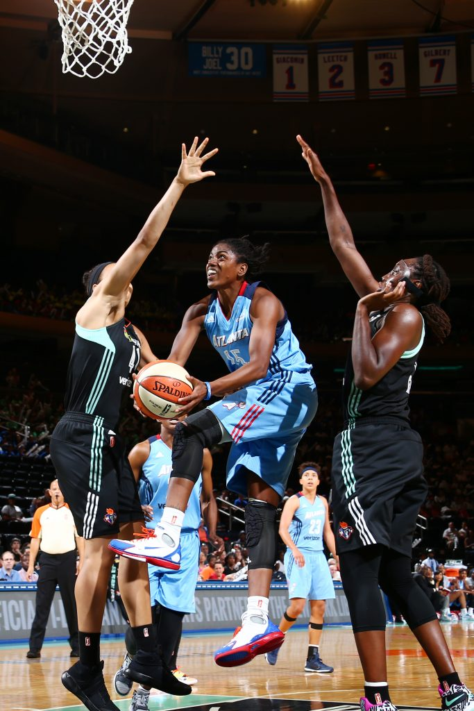 NEW YORK, NY - JULY 13: Tiffany Hayes #15 of the Atlanta Dream goes for a lay up against the New York Liberty on July 13, 2016 at Madison Square Garden in New York, New York. NOTE TO USER: User expressly acknowledges and agrees that, by downloading and or using this photograph, User is consenting to the terms and conditions of the Getty Images License Agreement. Mandatory Copyright Notice: Copyright 2016 NBAE (Photo by Nathaniel S. Butler/NBAE via Getty Images)