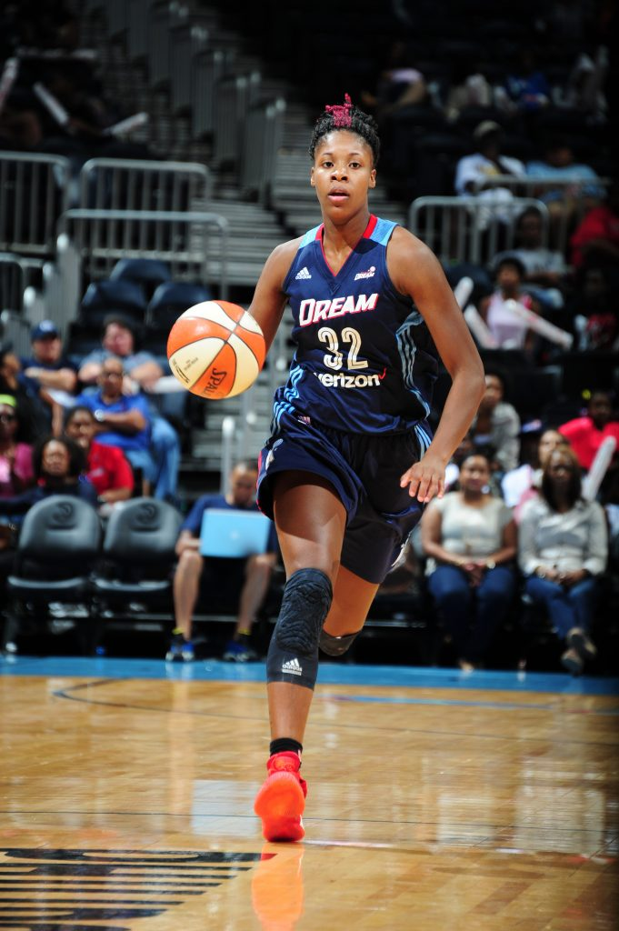 ATLANTA, GA - SEPTEMBER 15: Bria Holmes #32 of the Atlanta Dream brings the ball up court against the Washington Mystics on September 15, 2016 at Philips Arena in Atlanta, Georgia. NOTE TO USER: User expressly acknowledges and agrees that, by downloading and/or using this Photograph, user is consenting to the terms and conditions of the Getty Images License Agreement. Mandatory Copyright Notice: Copyright 2016 NBAE (Photo by Scott Cunningham/NBAE via Getty Images)