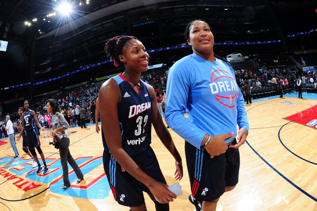 ATLANTA, GA - SEPTEMBER 15: Bria Holmes #32 of the Atlanta Dream and Markeisha Gatling #34 of the Atlanta Dream celebrate a win against the Washington Mystics on September 15, 2016 at Philips Arena in Atlanta, Georgia. NOTE TO USER: User expressly acknowledges and agrees that, by downloading and/or using this Photograph, user is consenting to the terms and conditions of the Getty Images License Agreement. Mandatory Copyright Notice: Copyright 2016 NBAE (Photo by Scott Cunningham/NBAE via Getty Images)