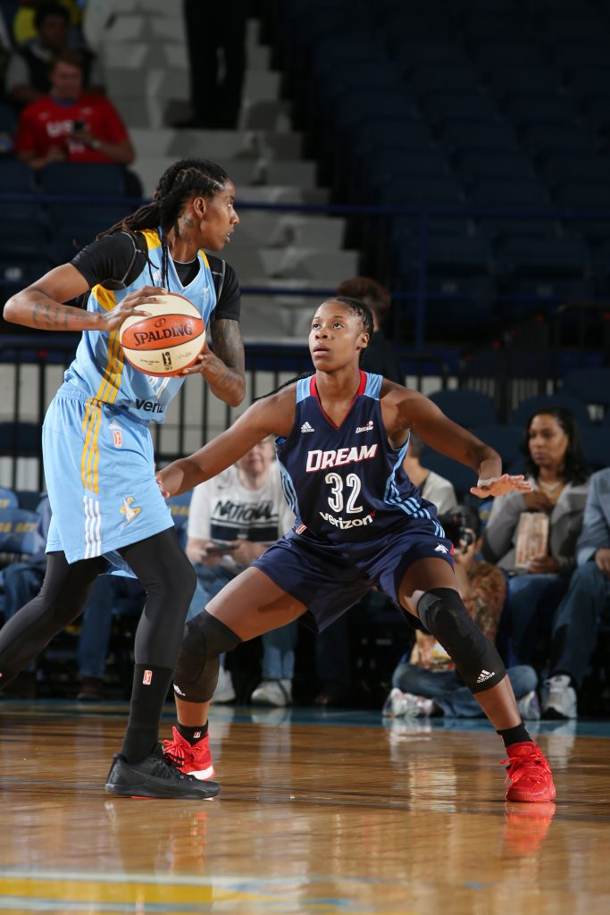 ROSEMONT, IL - SEPTEMBER 25: Jessica Breland #51 of the Chicago Sky handles the ball against Bria Holmes #32 of the Atlanta Dream during Round Two of the 2016 WNBA Playoffs on September 25, 2016 at Allstate Arena in Rosemont, IL. NOTE TO USER: User expressly acknowledges and agrees that, by downloading and or using this photograph, User is consenting to the terms and conditions of the Getty Images License Agreement. Mandatory Copyright Notice: Copyright 2016 NBAE (Photo by Gary Dineen/NBAE via Getty Images)