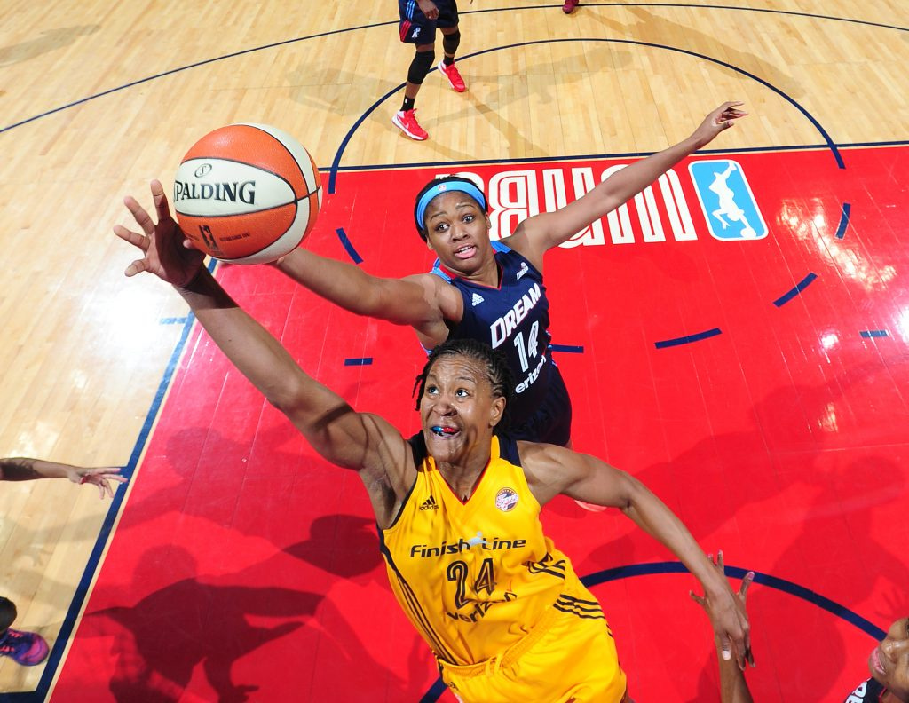 ATLANTA, GA - MAY 29: Tamika Catchings #24 of the Indiana Fever and Rachel Hollivay #14 of the Atlanta Dream go after a rebound on May 29, 2016 at Philips Arena in Atlanta, Georgia. NOTE TO USER: User expressly acknowledges and agrees that, by downloading and/or using this Photograph, user is consenting to the terms and conditions of the Getty Images License Agreement. Mandatory Copyright Notice: Copyright 2016 NBAE (Photo by Scott Cunningham/NBAE via Getty Images)