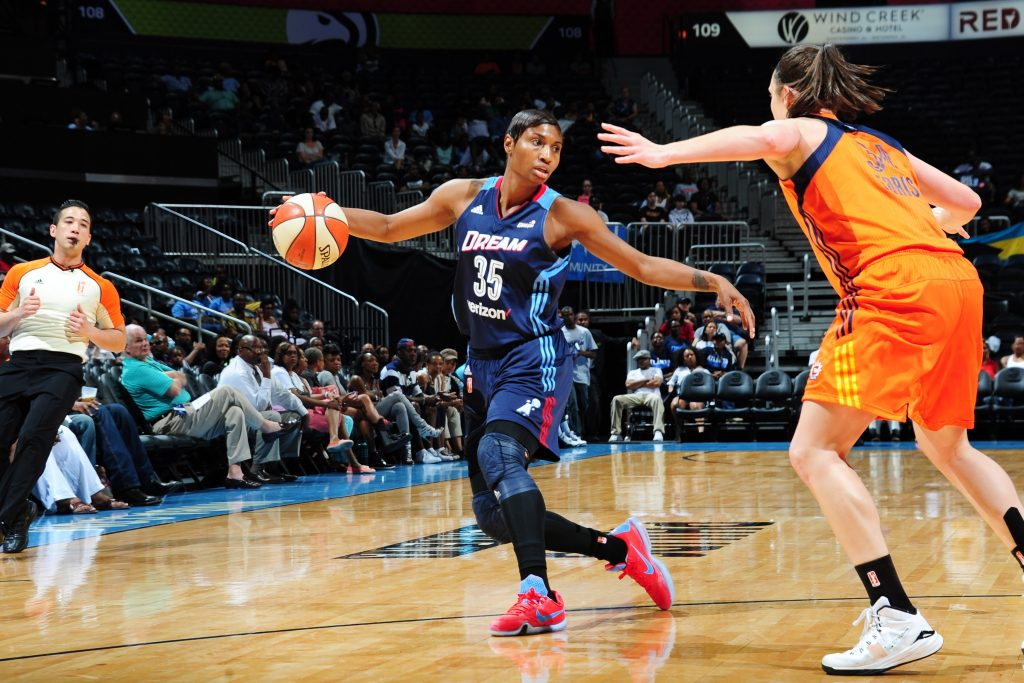 ATLANTA, GA - JUNE 12: Angel McCoughtry #35 of the Atlanta Dream defends the ball against the Connecticut Sun during the game on June 12, 2016 at Philips Arena in Atlanta, Georgia. NOTE TO USER: User expressly acknowledges and agrees that, by downloading and or using this Photograph, user is consenting to the terms and conditions of the Getty Images License Agreement. Mandatory Copyright Notice: Copyright 2016 NBAE (Photo by Scott Cunningham/NBAE via Getty Images)