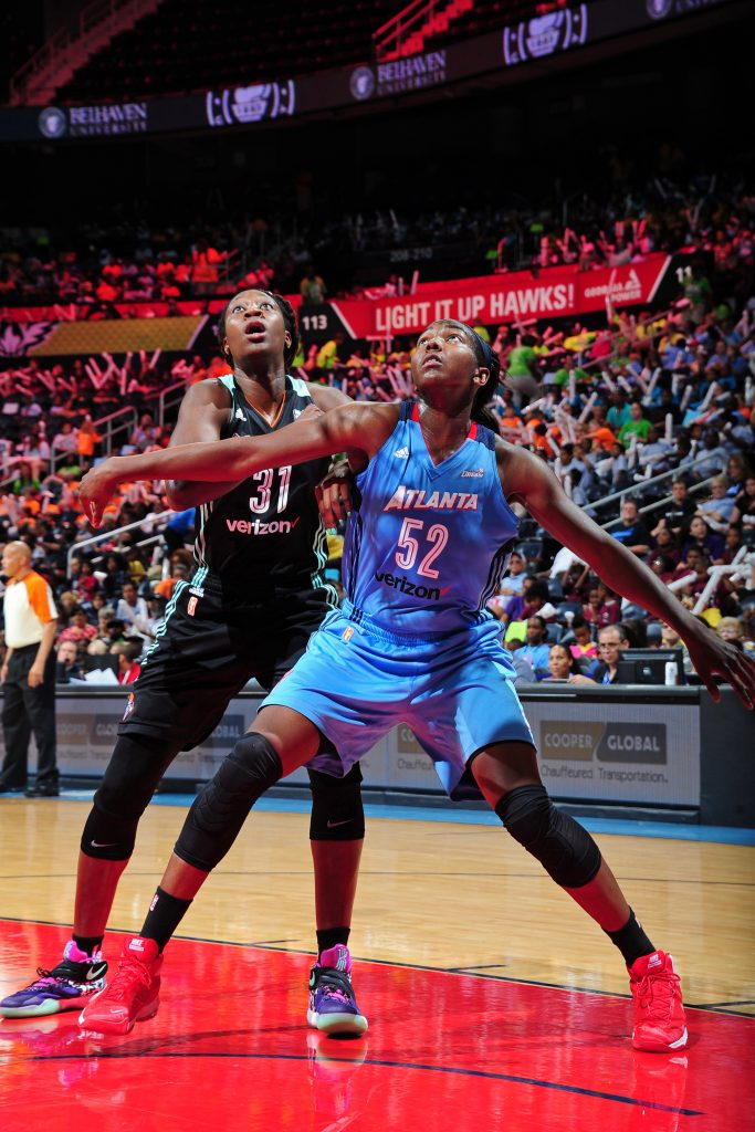 ATLANTA, GA - JUNE 22: Elizabeth Williams #52 of the Atlanta Dream boxes out Tina Charles #31 of the New York Liberty during a WNBA game on June 22, 2016 at Philips Arena in Atlanta, Georgia. NOTE TO USER: User expressly acknowledges and agrees that, by downloading and/or using this Photograph, user is consenting to the terms and conditions of the Getty Images License Agreement. Mandatory Copyright Notice: Copyright 2016 NBAE (Photo by Scott Cunningham/NBAE via Getty Images)
