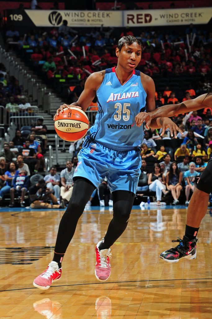 ATLANTA, GA - JUNE 22: Angel McCoughtry #35 of the Atlanta Dream drives to the basket against the New York Liberty during a WNBA game on June 22, 2016 at Philips Arena in Atlanta, Georgia. NOTE TO USER: User expressly acknowledges and agrees that, by downloading and/or using this Photograph, user is consenting to the terms and conditions of the Getty Images License Agreement. Mandatory Copyright Notice: Copyright 2016 NBAE (Photo by Scott Cunningham/NBAE via Getty Images)