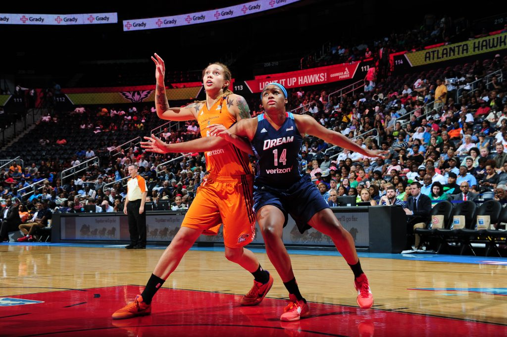 ATLANTA, GA - JULY 3: Rachel Hollivay #14 of the Atlanta Dream boxes out against Brittney Griner #42 of the Phoenix Mercury on July 3, 2016 at Philips Arena in Atlanta, Georgia. NOTE TO USER: User expressly acknowledges and agrees that, by downloading and/or using this Photograph, user is consenting to the terms and conditions of the Getty Images License Agreement. Mandatory Copyright Notice: Copyright 2016 NBAE (Photo by Scott Cunningham/NBAE via Getty Images)