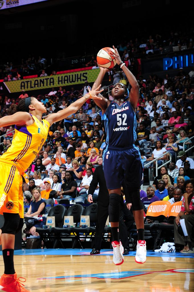 ATLANTA, GA - JULY 17: Elizabeth Williams #52 of the Atlanta Dream shoots the ball against Candace Parker #3 of the Los Angeles Sparks on July 17, 2016 at Philips Arena in Atlanta, Georgia. NOTE TO USER: User expressly acknowledges and agrees that, by downloading and/or using this Photograph, user is consenting to the terms and conditions of the Getty Images License Agreement. Mandatory Copyright Notice: Copyright 2016 NBAE (Photo by Scott Cunningham/NBAE via Getty Images)