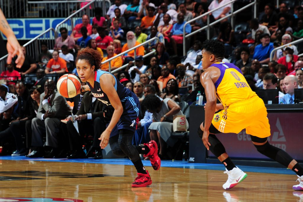 ATLANTA, GA - JULY 17: Carla Cortijo #8 of the Atlanta Dream drives to the basket against the Los Angeles Sparks on July 17, 2016 at Philips Arena in Atlanta, Georgia. NOTE TO USER: User expressly acknowledges and agrees that, by downloading and/or using this Photograph, user is consenting to the terms and conditions of the Getty Images License Agreement. Mandatory Copyright Notice: Copyright 2016 NBAE (Photo by Scott Cunningham/NBAE via Getty Images)