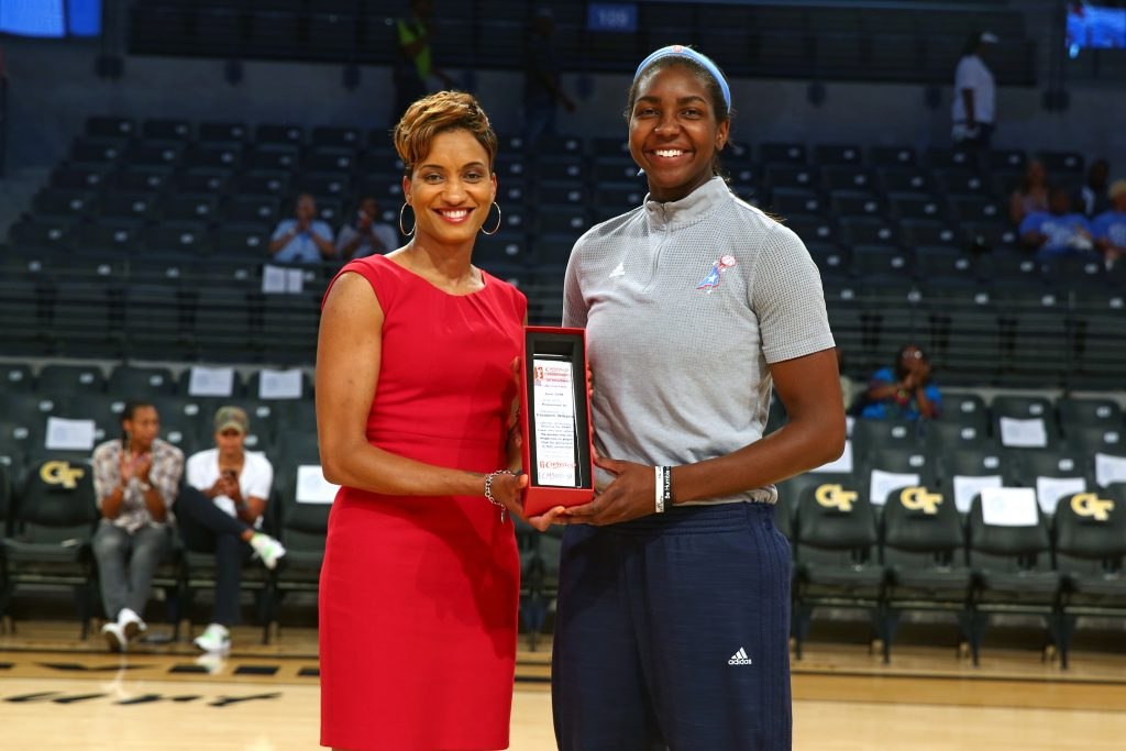 ATLANTA, GA - JULY 22: Elizabeth Williams #52 of the Atlanta Dream receives the June WNBA Cares Community Assist Award presented by State Farm for her efforts to encourage youth education and literacy through the Dreams recent community initiatives before the game against the Dallas Wings on July 22, 2016 at McCamish Pavilion in Atlanta, Georgia. NOTE TO USER: User expressly acknowledges and agrees that, by downloading and or using this Photograph, user is consenting to the terms and conditions of the Getty Images License Agreement. Mandatory Copyright Notice: Copyright 2016 NBAE (Photo by Kevin Liles/NBAE via Getty Images)
