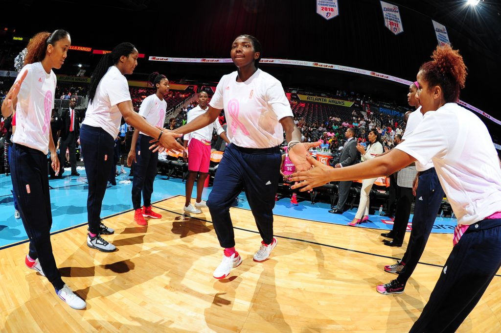 ATLANTA, GA - AUGUST 28: Elizabeth Williams #52 of the Atlanta Dream is introduced before the game against the Connecticut Sun on August 28, 2016 at Philips Arena in Atlanta, Georgia. NOTE TO USER: User expressly acknowledges and agrees that, by downloading and/or using this Photograph, user is consenting to the terms and conditions of the Getty Images License Agreement. Mandatory Copyright Notice: Copyright 2016 NBAE (Photo by Scott Cunningham/NBAE via Getty Images)