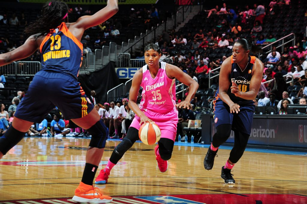 ATLANTA, GA - AUGUST 28: Angel McCoughtry #35 of the Atlanta Dream handles the ball against the Connecticut Sun on August 28, 2016 at Philips Arena in Atlanta, Georgia. NOTE TO USER: User expressly acknowledges and agrees that, by downloading and/or using this Photograph, user is consenting to the terms and conditions of the Getty Images License Agreement. Mandatory Copyright Notice: Copyright 2016 NBAE (Photo by Scott Cunningham/NBAE via Getty Images)