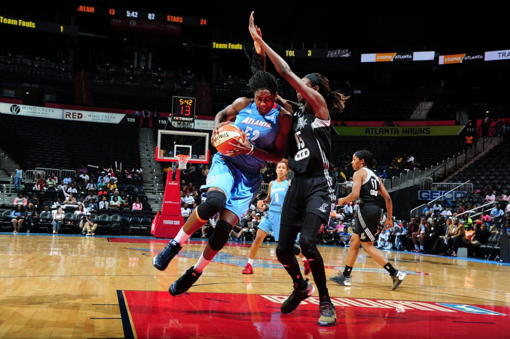 ATLANTA, GA - SEPTEMBER 13: Elizabeth Williams #52 of the Atlanta Dream handles the ball against the San Antonio Stars on September 13, 2016 at Philips Arena in Atlanta, Georgia. NOTE TO USER: User expressly acknowledges and agrees that, by downloading and/or using this Photograph, user is consenting to the terms and conditions of the Getty Images License Agreement. Mandatory Copyright Notice: Copyright 2016 NBAE (Photo by Scott Cunningham/NBAE via Getty Images)