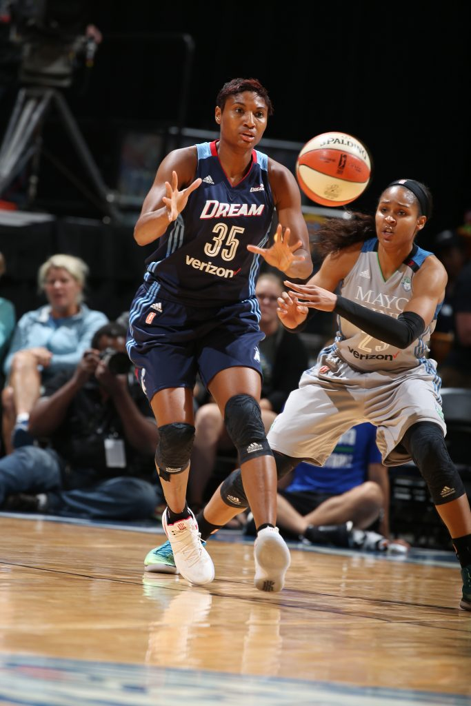 MINNEAPOLIS, MN - SEPTEMBER 17: Angel McCoughtry #35 of the Atlanta Dream passes the ball against Maya Moore #23 of the Minnesota Lynx on September 17, 2016 at Target Center in Minneapolis, Minnesota. NOTE TO USER: User expressly acknowledges and agrees that, by downloading and or using this Photograph, user is consenting to the terms and conditions of the Getty Images License Agreement. Mandatory Copyright Notice: Copyright 2016 NBAE (Photo by David Sherman/NBAE via Getty Images)