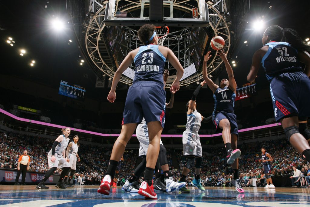 MINNEAPOLIS, MN - SEPTEMBER 17: Rachel Hollivay #14 of the Atlanta Dream shoots the ball against the Minnesota Lynx on September 17, 2016 at Target Center in Minneapolis, Minnesota. NOTE TO USER: User expressly acknowledges and agrees that, by downloading and or using this Photograph, user is consenting to the terms and conditions of the Getty Images License Agreement. Mandatory Copyright Notice: Copyright 2016 NBAE (Photo by David Sherman/NBAE via Getty Images)