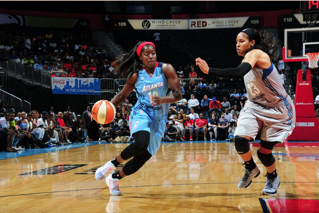 ATLANTA, GA - JUNE 10: Matee Ajavon #10 of the Atlanta Dream drives to the basket against Maya Moore #23 of the Minnesota Lynx on June 10, 2016 at Philips Arena in Atlanta, Georgia. NOTE TO USER: User expressly acknowledges and agrees that, by downloading and/or using this Photograph, user is consenting to the terms and conditions of the Getty Images License Agreement. Mandatory Copyright Notice: Copyright 2016 NBAE (Photo by Scott Cunningham/NBAE via Getty Images)