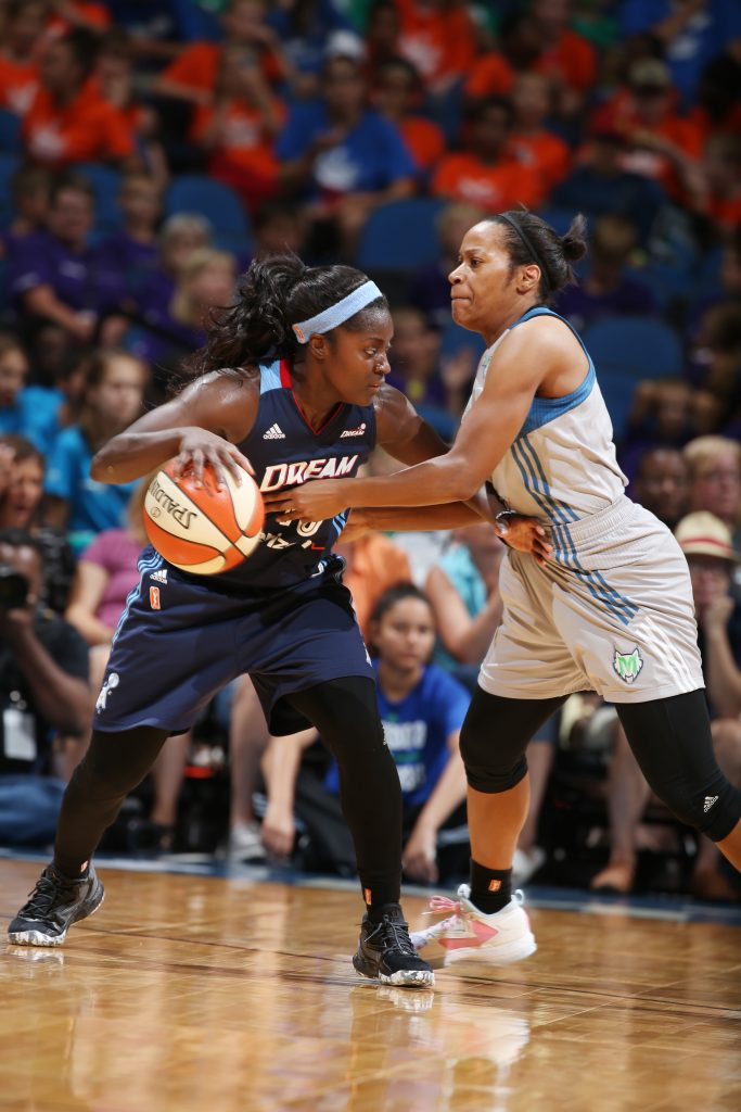 MINNEAPOLIS, MN - JULY 20: Matee Ajavon #10 of the Atlanta Dream handles the ball against Jia Perkins #7 of the Minnesota Lynx on July 20, 2016 at Target Center in Minneapolis, Minnesota. NOTE TO USER: User expressly acknowledges and agrees that, by downloading and or using this Photograph, user is consenting to the terms and conditions of the Getty Images License Agreement. Mandatory Copyright Notice: Copyright 2016 NBAE (Photo by David Sherman/NBAE via Getty Images)