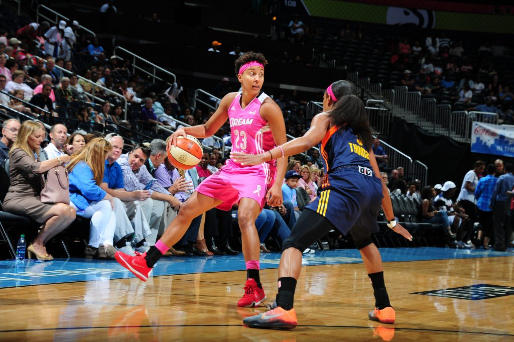 ATLANTA, GA - AUGUST 28: Layshia Clarendon #23 of the Atlanta Dream handles the ball against the Connecticut Sun on August 28, 2016 at Philips Arena in Atlanta, Georgia. NOTE TO USER: User expressly acknowledges and agrees that, by downloading and/or using this Photograph, user is consenting to the terms and conditions of the Getty Images License Agreement. Mandatory Copyright Notice: Copyright 2016 NBAE (Photo by Scott Cunningham/NBAE via Getty Images)