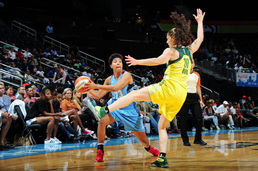 ATLANTA, GA - SEPTEMBER 4: Layshia Clarendon #23 of the Atlanta Dream handles the ball against the Seattle Storm on September 4, 2016 at Philips Arena in Atlanta, Georgia. NOTE TO USER: User expressly acknowledges and agrees that, by downloading and/or using this Photograph, user is consenting to the terms and conditions of the Getty Images License Agreement. Mandatory Copyright Notice: Copyright 2016 NBAE (Photo by Scott Cunningham/NBAE via Getty Images)