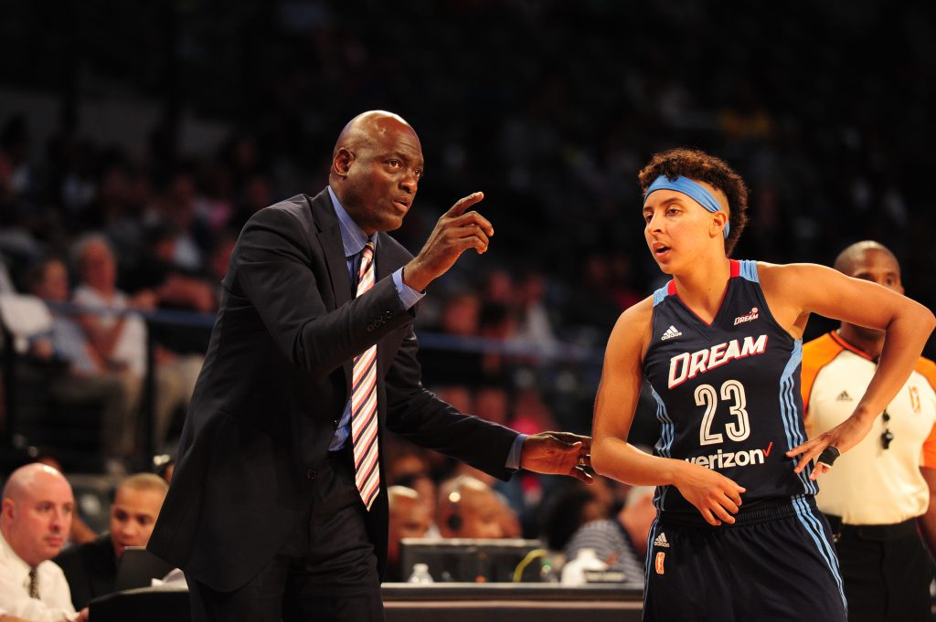 ATLANTA, GA - SEPTEMBER 21: Head coach Michael Cooper of the Atlanta Dream and Layshia Clarendon #23 of the Atlanta Dream talk during the game against the Seattle Storm during Round One of the 2016 WNBA Playoffs on September 21, 2016 at the Hank McCamish Pavilion in Atlanta, Georgia. NOTE TO USER: User expressly acknowledges and agrees that, by downloading and/or using this Photograph, user is consenting to the terms and conditions of the Getty Images License Agreement. Mandatory Copyright Notice: Copyright 2016 NBAE (Photo by Scott Cunningham/NBAE via Getty Images)
