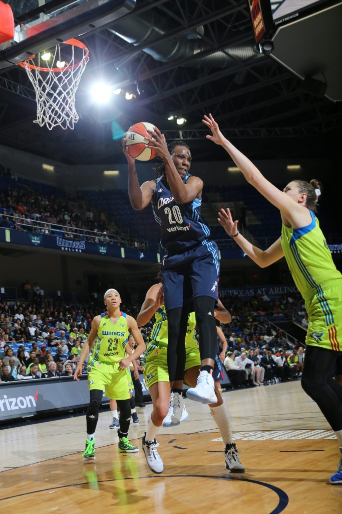 ARLINGTON, TX - MAY 27: Sancho Lyttle #20 of the Atlanta Dream grabs the rebound against the Dallas Wings on May 27, 2016 at College Park Center in Arlington, Texas. NOTE TO USER: User expressly acknowledges and agrees that, by downloading and or using this photograph, user is consenting to the terms and conditions of the Getty Images License Agreement. Mandatory Copyright Notice: Copyright 2016 NBAE (Photos by Layne Murdoch/NBAE via Getty Images)