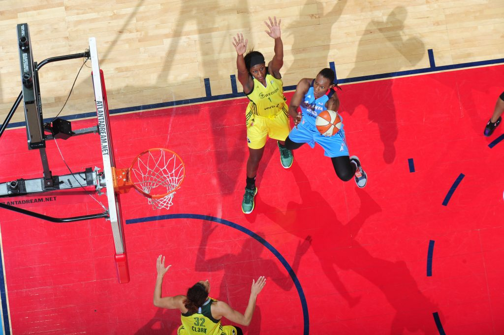 ATLANTA, GA - JULY 5: Sancho Lyttle #20 of the Atlanta Dream shoots the ball against Jewell Loyd #24 of the Seattle Storm on July 5, 2016 at Philips Arena in Atlanta, Georgia. NOTE TO USER: User expressly acknowledges and agrees that, by downloading and/or using this Photograph, user is consenting to the terms and conditions of the Getty Images License Agreement. Mandatory Copyright Notice: Copyright 2016 NBAE (Photo by Scott Cunningham/NBAE via Getty Images)